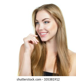 Beauty portrait of young woman with beautiful face and long healthy fair hair, studio shot of attractive girl over white background