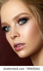 Beauty portrait of young woman with fashion make up. Perfect skin and colorful smokey eyes makeup. Studio shot. Sensuality, passion, trendy luxurious makeup concept.