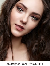 Beauty portrait of young woman. Female with brown hair.