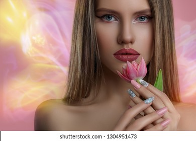 Beauty portrait of  young woman with flower . Model girl with professional make-up and Nail art  manicure over pink background.