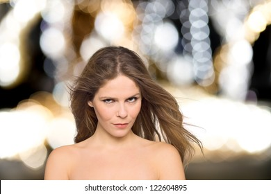 Beauty portrait of a young woman over bokeh background