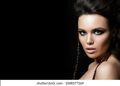 Beauty portrait of young woman. Perfect skin and evening makeup. Studio shot. Sensuality, passion, trendy youth makeup concept. Copy space