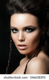 Beauty portrait of young woman. Perfect skin and evening makeup. Studio shot. Sensuality, passion, trendy youth makeup concept.