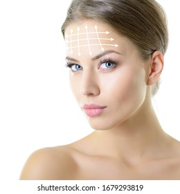 Beauty portrait of young woman with white lines on forehead for cosmetic medical procedures or plastic surgery. Skin care, anti-aging, lifting, rejuvenation concept