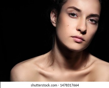Beauty portrait.Young gorgeous girl .Beautiful .Girl.Close-up fashion.Black background.