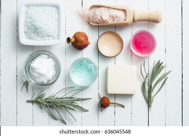 beauty product samples on white wooden table background