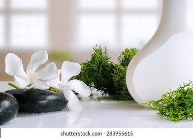 beauty product with seaweed in white container on a white glass table in a bath
