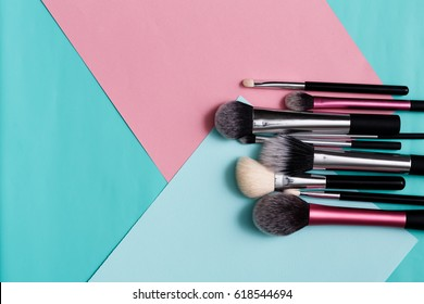 Beauty products, everyday make-up. Cosmetic brushes on bright background, flat lay, top view