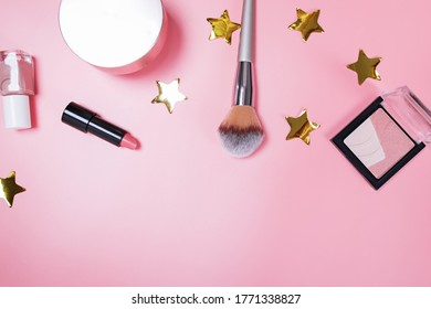 Beauty products flat lay on pink background. Brush, lipstic, nailpolish and other