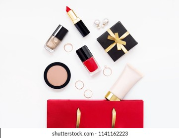 Beauty products, makeup tools and gift box on white background. Shopping concept. Top view