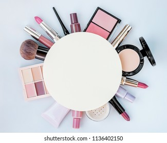 Beauty products on a beige background. Eyeliner, blushes, concealer, foundation, lipsticks, nail polishes, mascara.