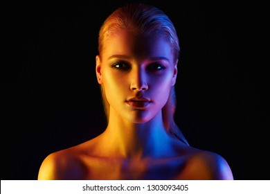 Beauty Rainbow woman. Beautiful Girl in color bright lights