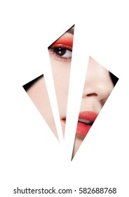 Beauty red eyes and lips makeup fashion model on black background looking through three white triangles. Creative artwork