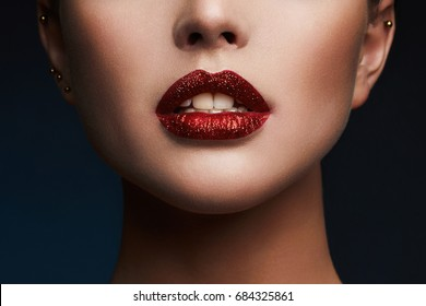 Beauty Red Lips Makeup Detail. Beautiful Sensual woman. glitter lips,lipstick or Lip gloss