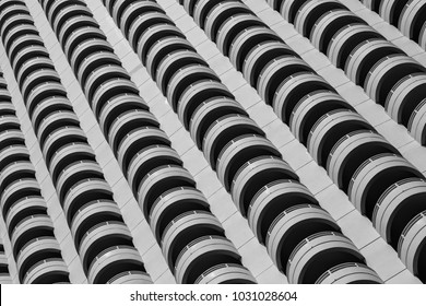 beauty of repetition shape conceptual art, terrace of skyscraper building in closeup black and white