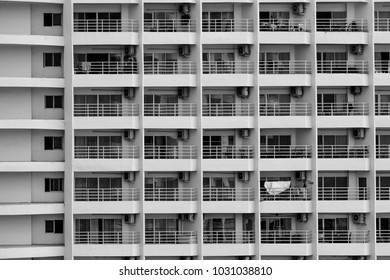 beauty of repetition shape conceptual art, exterior of apartment building with many balcony terrace windows