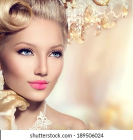 Beauty Retro Woman Portrait. Glamour Lady. Vintage styled Girl with perfect make up and hairstyle. Luxury interior