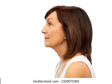 beauty, rhinoplasty and old people concept - profile of senior woman over white background