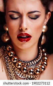 beauty rich brunette woman with a lot of jewellery, hispanic curly lady posing very emotional