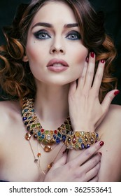 beauty rich woman with luxury jewellery looks like mature close up, bright makeup