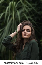 Beauty Romantic Girl Outdoor. Beautiful Teenage Model Dressed in Fashionable Green Dress Posing Outdoors in park. Toned in warm colors. Fashion Look