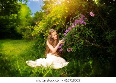 Beauty Romantic Girl Outdoors. Beautiful Teenage Model girl Dressed in Dress in Sunlight. Blowing Long Hair.