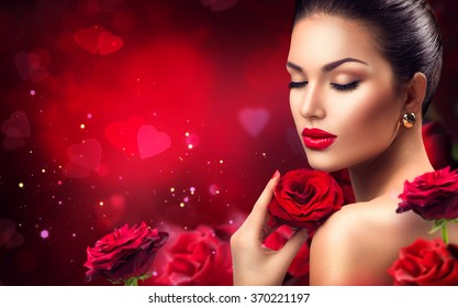 Beauty romantic woman with Red Rose flowers. Valentine. Red Lips and Nails. Beautiful Luxury Makeup and Manicure. Valentines Day border design. Portrait of fashion model girl on blurred red background