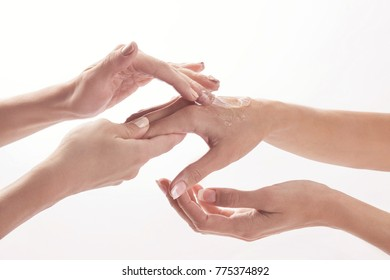 Beauty salon, applying moisturizing cream onto the hands and massaging
