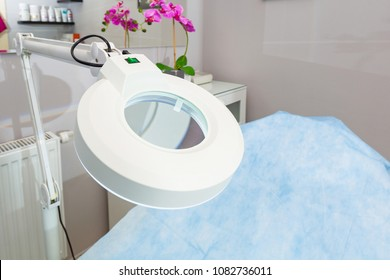 Beauty salon equipment with bed and lamp