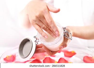 Beauty salon, manicure with hands peeling. Jar of cosmetic preparation Spa & Wellness