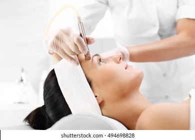 Beauty salon, microdermabrasion.woman during a microdermabrasion treatment in beauty salon