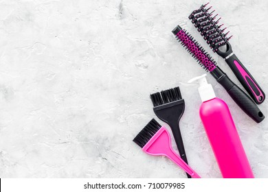 beauty salon pink work tools with comb for hair dress and coloring on stone background top view mock up