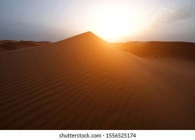 The beauty of the sand dunes in the Sahara Desert in Morocco. The Sahara Desert is the largest hot desert and one of the harshest environments in the world.