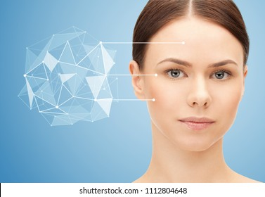 beauty, science and future technology concept - portrait of beautiful woman with low poly shape projection pointing to face over blue background