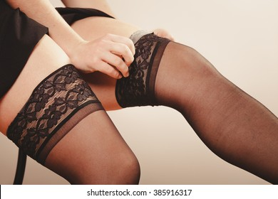 Beauty and sexuality of women. Sexy part body woman model wearing fit on black panties pants stockings. Close up of female legs.