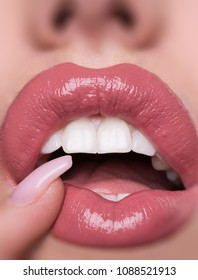 Beauty Sexy Female Lips Closeup. Hyaluronic acid for lips. Plastic surgery for lips, lip augmentation. Artificial lips. Beautiful Young Woman Mouth Receiving Hyaluronic Acid Injection. Cosmetology