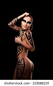 Beauty sexy girl in black tape dress, studio posed, bdsm