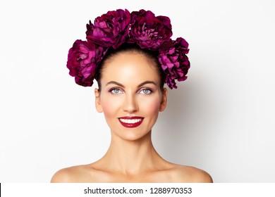 Beauty Sexy Model girl with peony flowers wreath. Beautiful brunette young woman perfect make-up, red seductive lips. Trendy makeup, beauty spa skin concept
