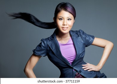 Beauty shot of Asian Peranankan fashion female model of mixed Chinese and Malay parentage