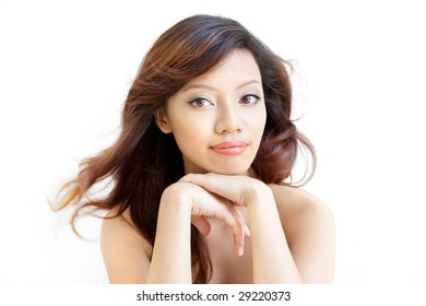 Beauty shot of an attentive chinese beautiful gal with an eager and enthusiastic expression