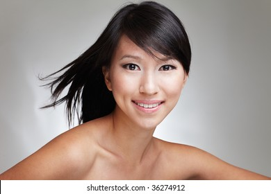 Beauty shot of an attractive Japanese beautiful gal with an eager and enthusiastic expression