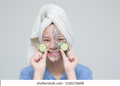 Beauty shot image of cute asian young girl with smile face in concept of cosmetic skin care mask cream with natural nutrition from nature vitamin, beautiful portriat of woman on white background.