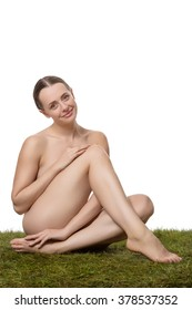 beauty shot of woman sitting on grass shot in the studio with white background