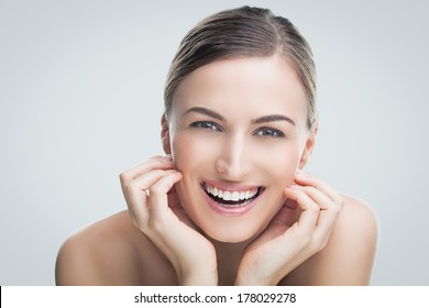 Beauty shot of a young Caucasian woman smiling.