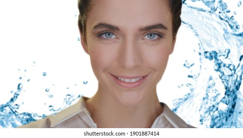 Beauty shot of young woman with perfect face skin just cleaned from impurities ready for moisturizing cream is smiling in camera on splash water background. Concept of skincare, cosmetics, healthcare