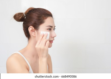 Beauty. Skin care concept. Woman removing makeup from her face.