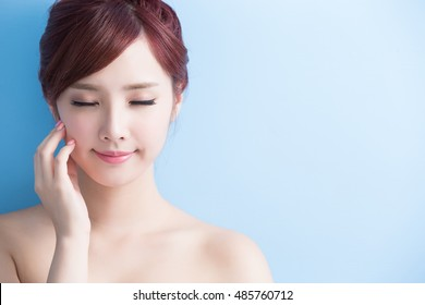 beauty  skin care woman relax closed eye isolated on bluebackground, asian