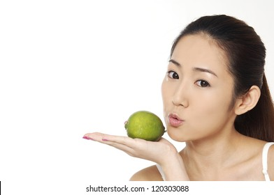 beauty skin care woman smiling close-up. and holding lemon,