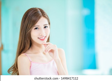 Beauty skin care woman touch her chin and smile to you at home