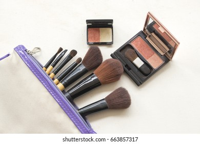 beauty skin face cosmetics makeup with small bag on white